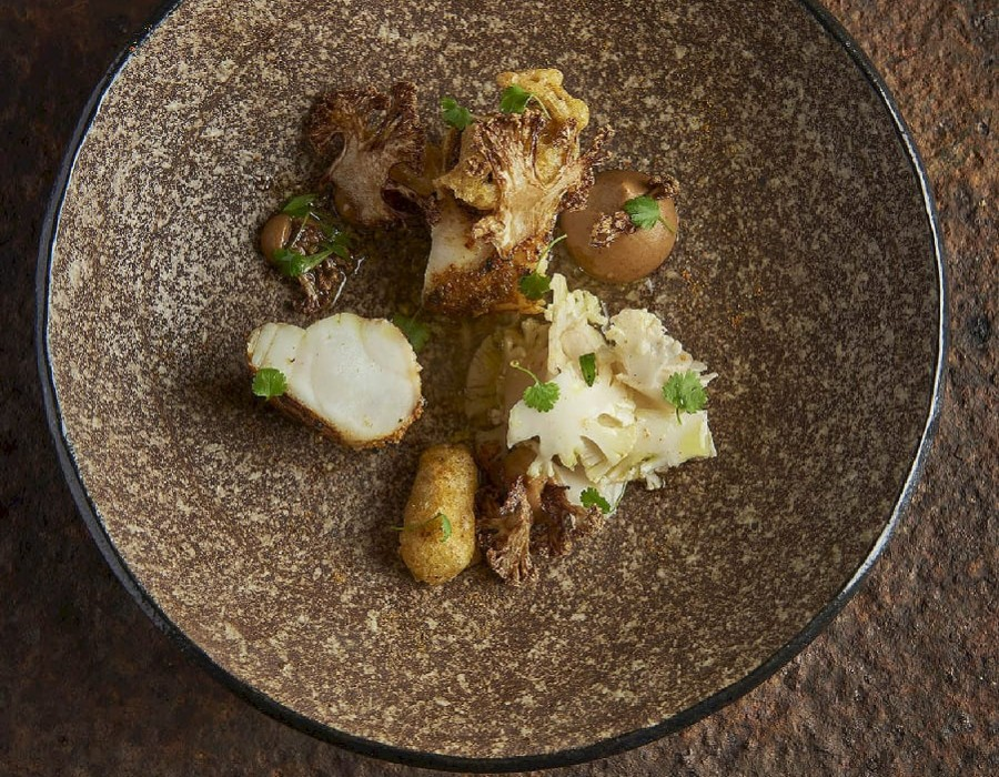 Adam Handling's dish - Monkfish, mussels, cauliflower, curry, dashi